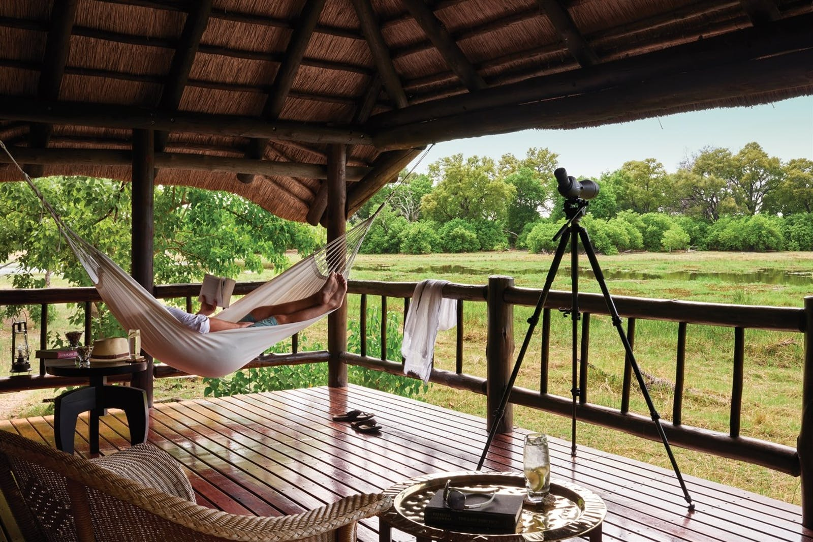 Hammock on terrace at Khwai River Lodge, A Belmond Safari, Botswana