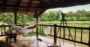 Hammock on terrace at Belmond Khwai River Lodge