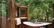 Outdoor rain shower and bathtub  at Belmond Khwai River Lodge