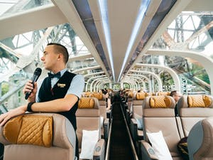 A Rocky Mountaineer Host onboard GoldLeaf Service