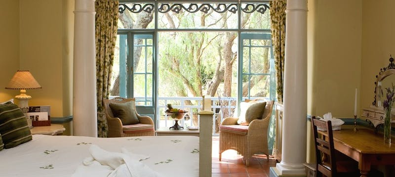 Bedroom with balcony at Franschhoek Country House and Villas