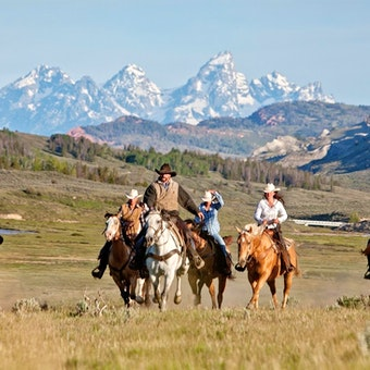 Riding With Back Drop Of The Grand Tetons