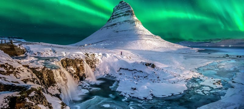 Northern Lights appear over Mount Kirkjufell