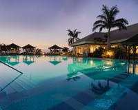 pool area in the evening at RedLevel at Gran Melia Palacio de Isora