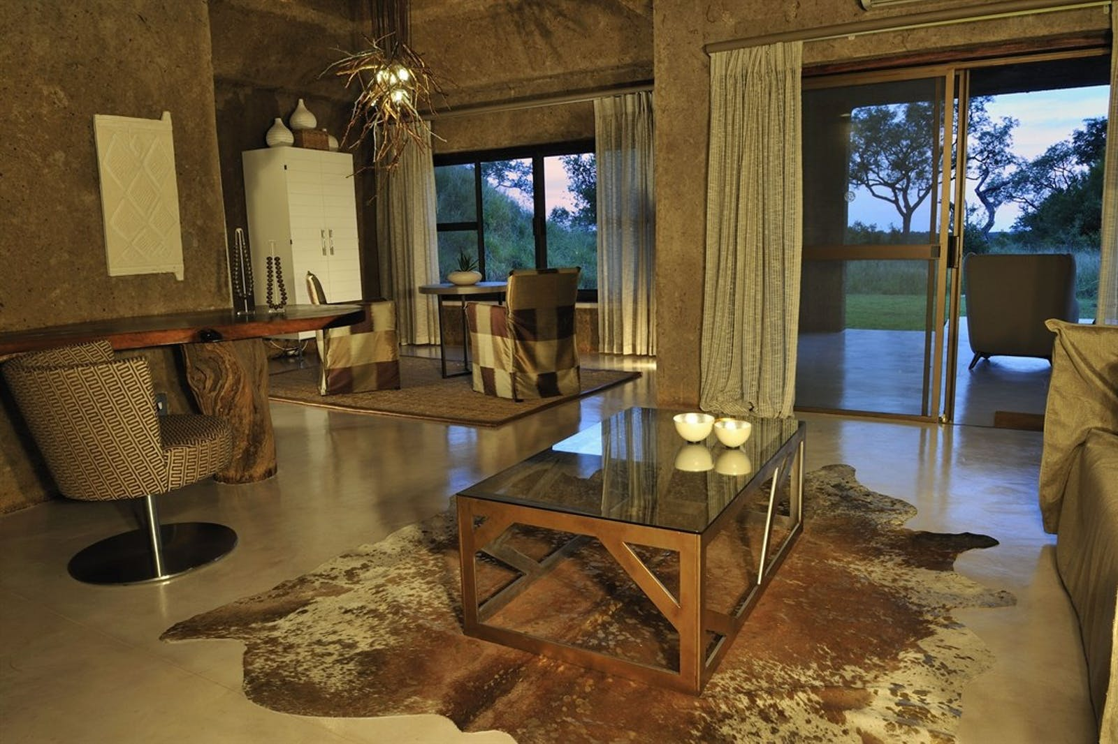 Bedroom lounge area at Sabi Sabi Earth Lodge, South Africa