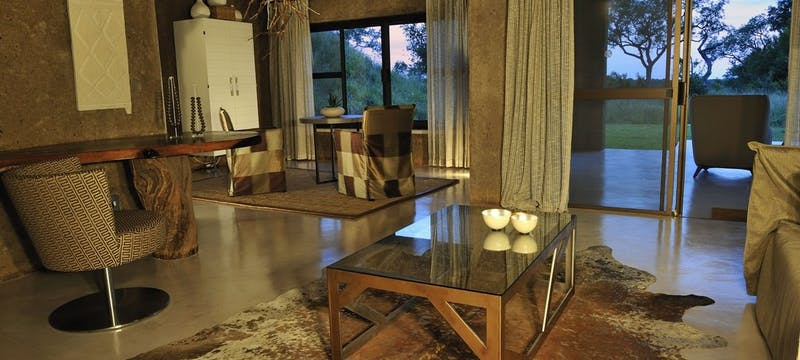 Bedroom lounge area at Sabi Sabi Earth Lodge, South Africa