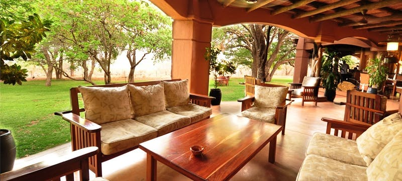 Outdoor lounge area at Sanctuary Chobe Chilwero