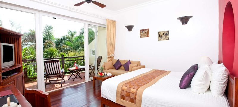 Guest bedroom at Victoria Hoi An Beach Resort & Spa